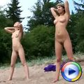 A couple of beach gymnasts exercising naked